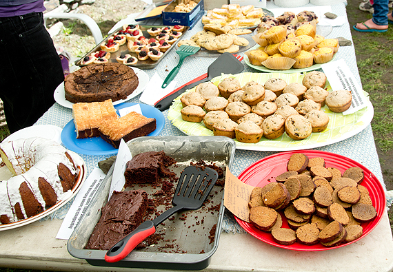 Table filled with cakes and cookies for Bake Sale